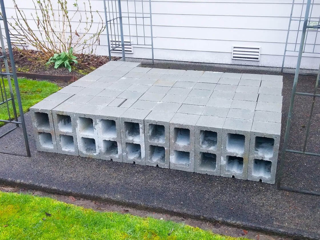 Cinder blocks laid out ready for garden bed construction
